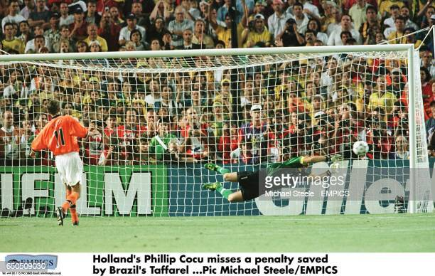 Holland's Philip Cocu sees his penalty saved by Brazil goalkeeper Taffarel