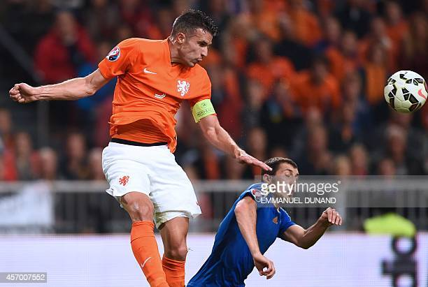 Holland's Robin van Persie heads the ball above Kazakhstan's Gafurzan Syumbayev during the Euro 2016 qualifying match between the Netherlands and...