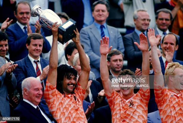 LR Holland's Ruud Gullit lifts the European Championship with Jan Wouters