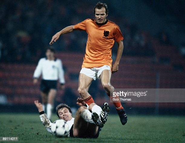 Holland's Willy Van Der Kerkhof is tackled by West German defender Bernd Dietz during the International in Eindhoven 11th October 1980