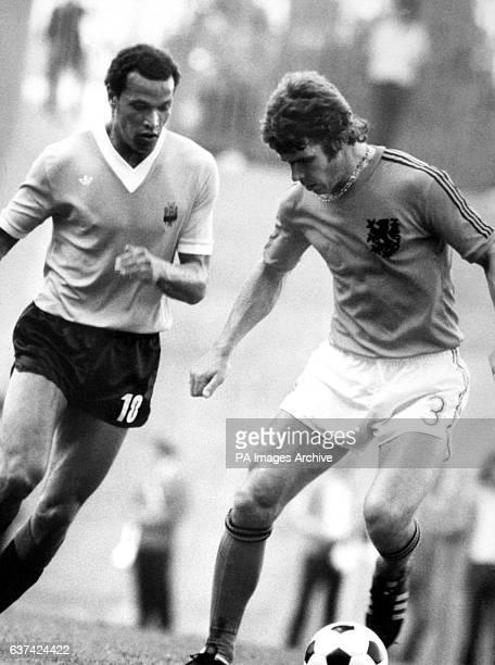 Holland's Wim van Hanegem is tracked by Uruguay's Walter Mantegazza