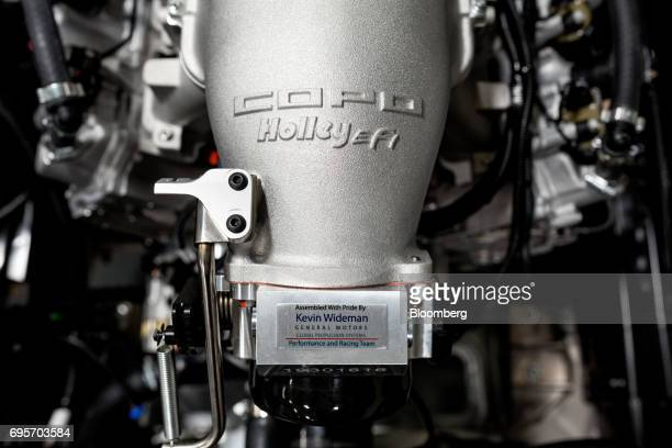 A Holley Performance Products Inc LS HiRam intake manifold sits inside a General Motors Co Chevrolet COPO Camaro at the company's build center in...
