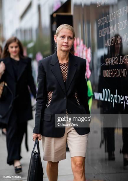 Holli Rogers wearing blazer shorts snake print boots is seen outside Natasha Zinko during London Fashion Week September 2018 on September 18 2018 in...
