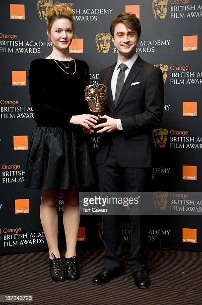 Holliday Grainger and Daniel Radcliffe attend the nomination announcement for The Orange British Academy Film Awards 2012 at BAFTA on January 17 2012...