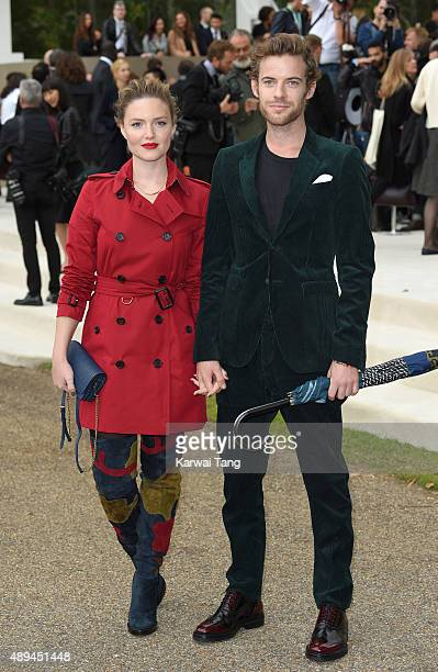 Holliday Grainger and Harry Treadaway attend the Burberry Prorsum show during London Fashion Week Spring/Summer 2016/17 at Kensington Gardens on...