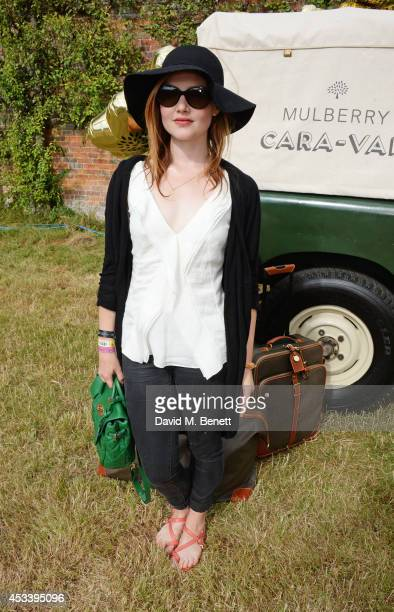 Holliday Grainger attends The Mulberry Wilderness Picnic with Cara Delevingne during Wilderness 2014 at Cornbury Park on August 9 2014 in Oxford...