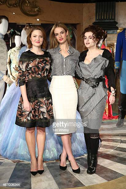Holliday Grainger Helena Bonham Carter and Lily James attend a photocall for the Cinderella Exhibition at Leicester Square on March 20 2015 in London...