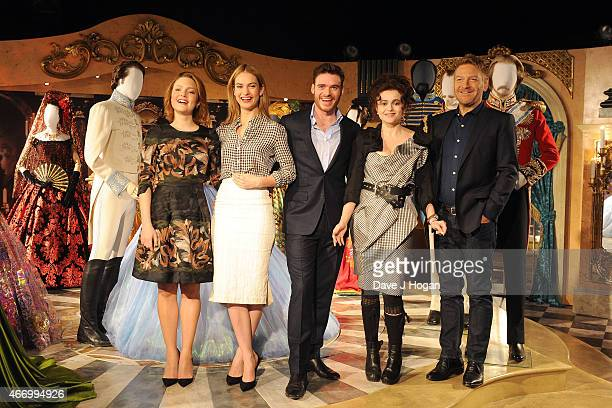 Holliday Grainger Lily James Richard Madden Helena Bonham Carter and Kenneth Branagh pose during the Cinderella Exhibition Launch Photocall at...