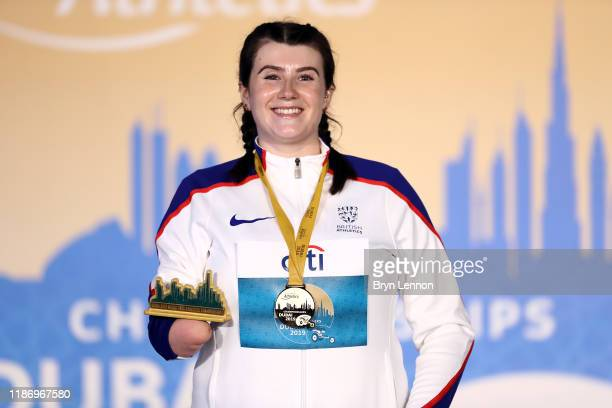 Hollie Arnold of Great Britain celebrates on the podium after winning the Women's Javelin Throw F46 on Day Five of the IPC World Para Athletics...