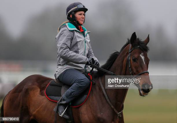 Hollie Conte riding Douvan on the gallops at Cheltenham racecourse on March 12 2018 in Cheltenham England