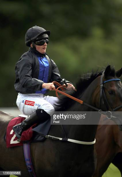 Hollie Doyle riding Oceanline heads back to the parade ring after the Join Racing TV Now Handicap at Haydock Park Racecourse on June 9, 2021...
