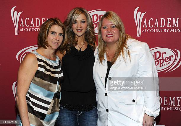 Hollie Fredrick singer Sarah Darling and Cindy Hourigan pose for a photo at the Dr Pepper Registration during rehearsals for the 46th Annual Academy...