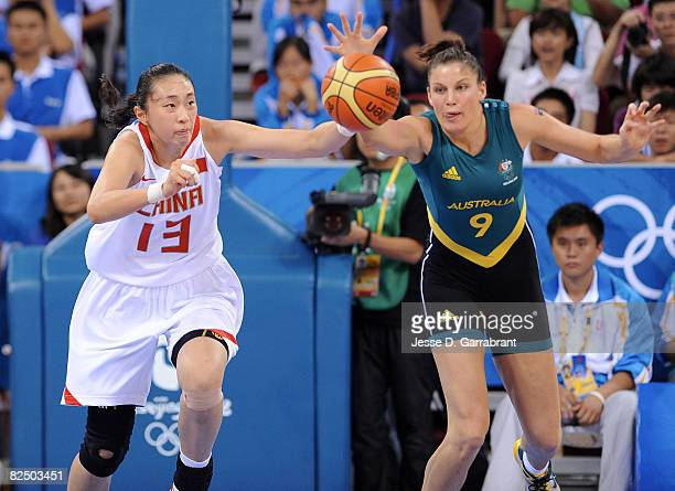 Hollie Grima of Australia goes for the loose ball against Liu Dan of China during the Women's Semifinals basketball game at the Wukesong Indoor...