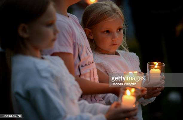 Hollie holds a candle during the candlelit vigil at North Down Crescent Park on August 13, 2021 in Plymouth, England. Police were called to a serious...
