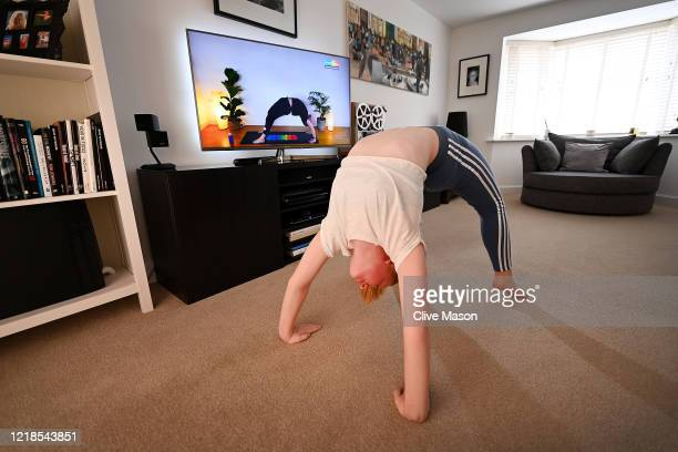 Hollie Mason the photographers daughter partakes in a live virtual yoga class hosted by Nick Higgins on April 13 2020 in Brixworth England On Monday...