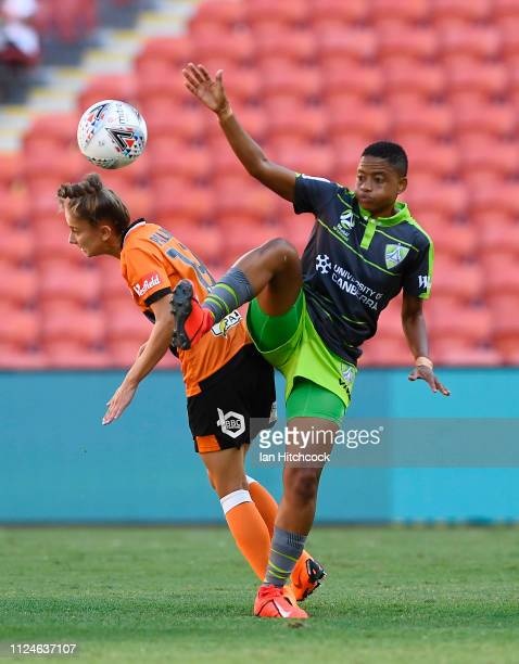 Hollie Palmer of the Roar and Refiloe Jane of Canberra United contest the ball during the round 13 WLeague match between the Brisbane Roar and...