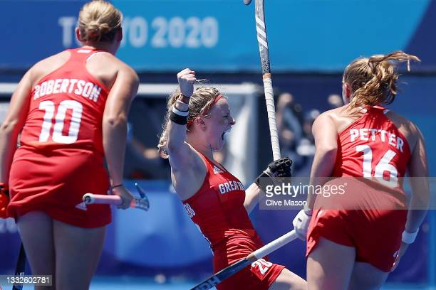 Hollie Pearne-Webb of Team Great Britain celebrates scoring their third goal with Sarah Robertson and Isabelle Petter during the Women's Bronze medal...