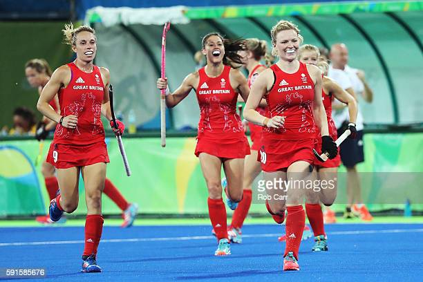 Hollie Webb of Great Britain and Susannah Townsend of Great Britain celebrate scoring during the Women's Semifinal match between New Zealand and...