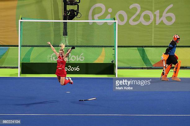 Hollie Webb of Great Britain celebrates scoring the winning penalty goal past Joyce Sombroek of Netherlands in the Women's Bronze Medal Match on Day...