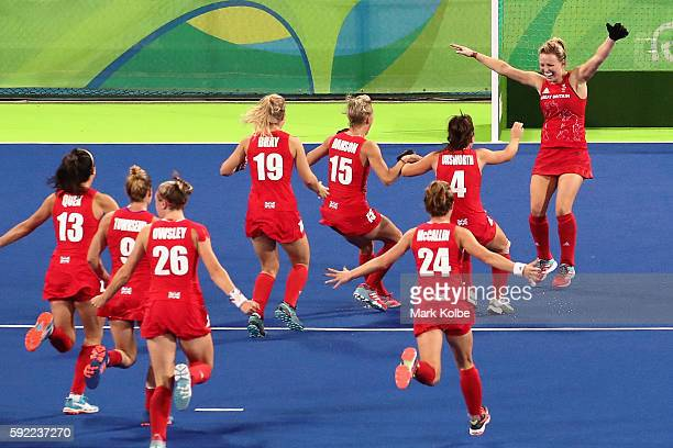Hollie Webb of Great Britain celebrates with teammates after scoring the game-winning penalty goal against the Netherlands during the Women's Gold...