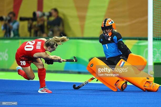 Hollie Webb of Great Britain scores the winning penalty goal past Joyce Sombroek of Netherlands during the Women's Gold Medal Match on Day 14 of the...