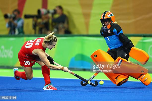 Hollie Webb of Great Britain scores the winning penalty past Joyce Sombroek of Netherlands during the Women's Gold Medal Match on Day 14 of the Rio...