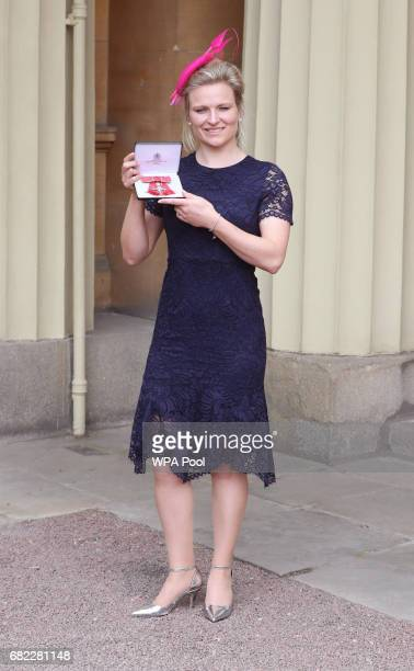 Hollie Webb poses after she was awarded an MBE by the Duke of Cambridge during an Investiture ceremony at Buckingham Palace on May 12 2017 in London...