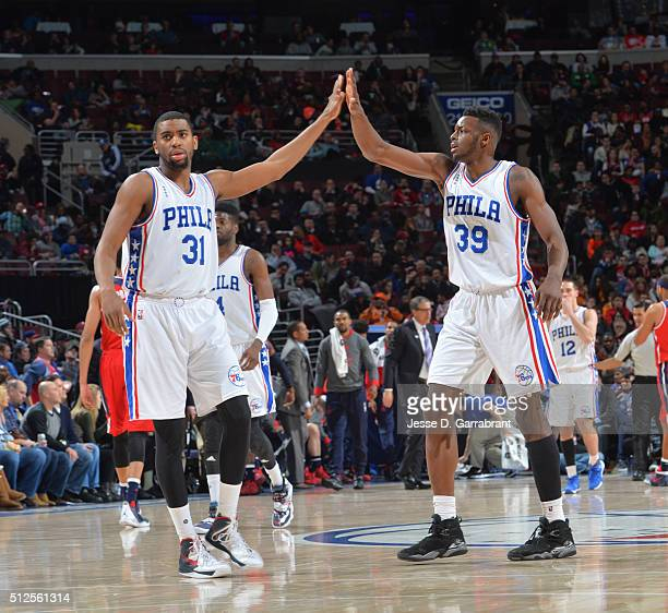 Hollis Thompson and Jerami Grant of the Philadelphia 76ers give each other high fives against the Washington Wizards at Wells Fargo Center on...