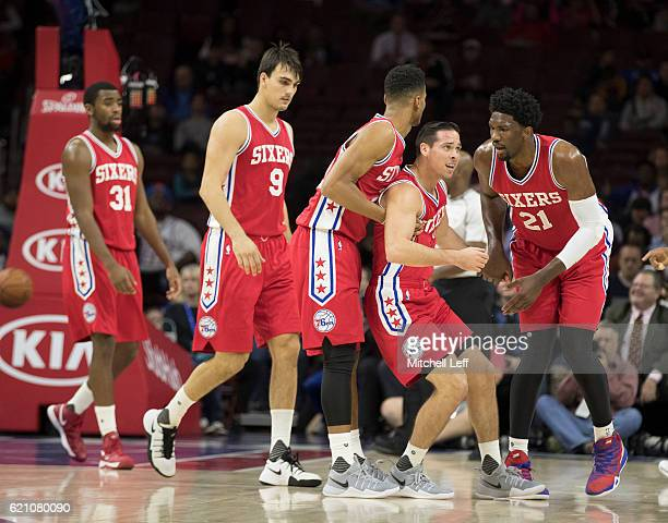 Hollis Thompson Dario Saric Timothe LuwawuCabarrot TJ McConnell and Joel Embiid of the Philadelphia 76ers huddle during the game against the Orlando...