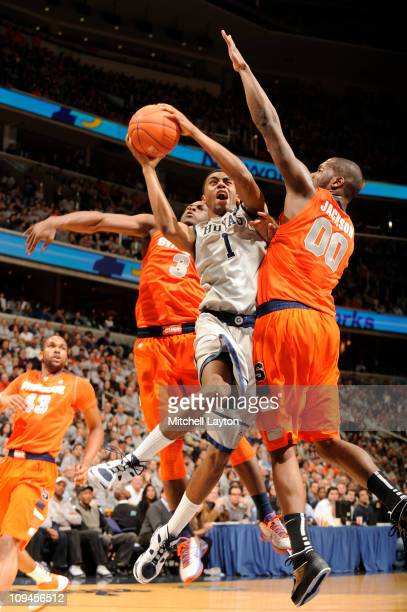 Hollis Thompson of the Georgetown Hoyas drives to basket between Dion Waiters and Rick Jackson of the Syracuse Orange during a college basketball...