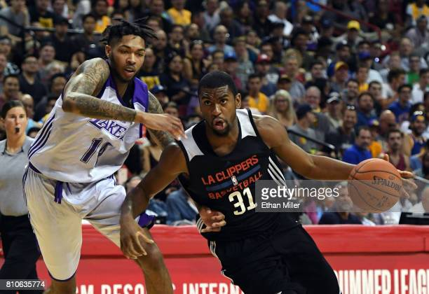 Hollis Thompson of the Los Angeles Clippers drives against Brandon Ingram of the Los Angeles Lakers during the 2017 Summer League at the Thomas Mack...