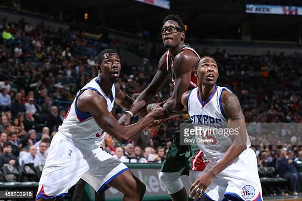 Hollis Thompson of the Philadelphia 76er Larry Sanders of the Milwaukee Bucks and Chris Johnson of the Philadelphia 76ers looks for the rebound...