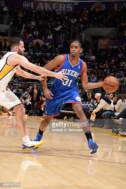 Hollis Thompson of the Philadelphia 76ers attempts a pass against Jordan Farmar of the Los Angeles Lakers at STAPLES Center on December 29 2013 in...