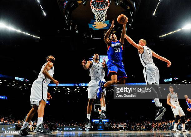 Hollis Thompson of the Philadelphia 76ers attempts a shot over Mason Plumlee and Joe Johnson of the Brooklyn Nets in the second half at the Barclays...