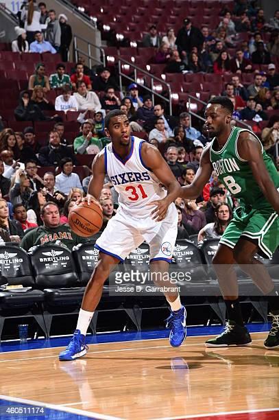 Hollis Thompson of the Philadelphia 76ers dribbles the ball against the Boston Celtics on December 15 2014 at Wells Fargo Center in Philadelphia PA...