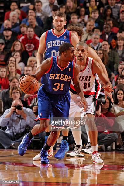 Hollis Thompson of the Philadelphia 76ers dribbles the ball against the Portland Trail Blazers on January 4 2014 at the Moda Center Arena in Portland...