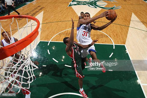 Hollis Thompson of the Philadelphia 76ers goes for the lay against Khris Middleton of the Milwaukee Bucks during the game on October 31 2014 at the...