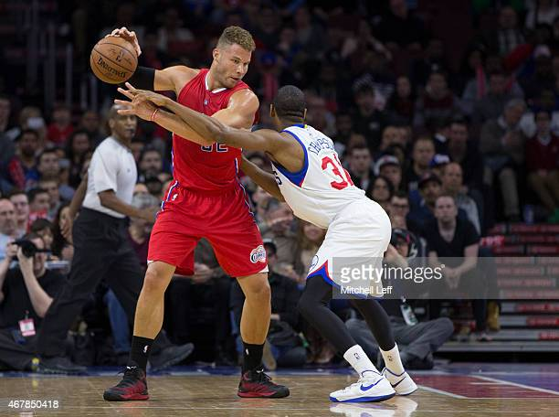 Hollis Thompson of the Philadelphia 76ers guards Blake Griffin of the Los Angeles Clippers on March 27 2015 at the Wells Fargo Center in Philadelphia...