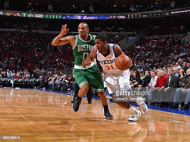 Hollis Thompson of the Philadelphia 76ers handles the ball against Avery Bradley of the Boston Celtics on November 19 2014 at Wells Fargo Center in...