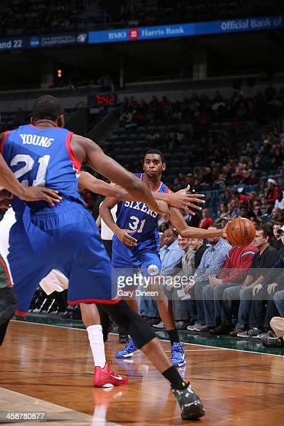 Hollis Thompson of the Philadelphia 76ers passes against the Milwaukee Bucks on December 21 2013 at the BMO Harris Bradley Center in Milwaukee...