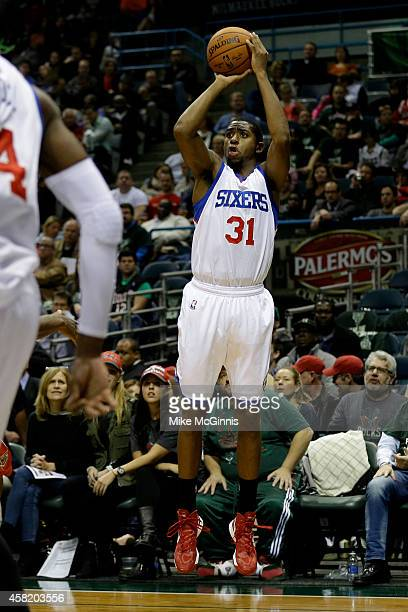 Hollis Thompson of the Philadelphia 76ers shoots a three pointer during the first half against the Milwaukee Bucks at BMO Harris Bradley Center on...