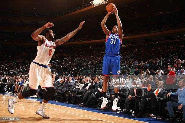 Hollis Thompson of the Philadelphia 76ers shoots against of the New York Knicks during a game at Madison Square Garden in New York City NOTE TO USER...