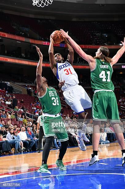 Hollis Thompson of the Philadelphia 76ers shoots against the Boston Celtics on October 16 2014 at Wells Fargo Center in Philadelphia Pennsylvania...
