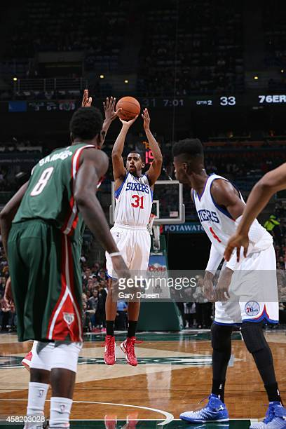 Hollis Thompson of the Philadelphia 76ers shoots against the Milwaukee Bucks during the game on October 31 2014 at the BMO Harris Bradley Center in...