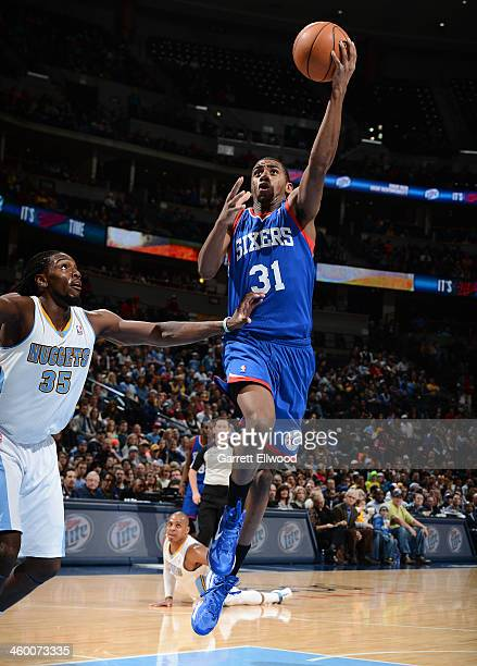 Hollis Thompson of the Philadelphia 76ers shoots against the Denver Nuggets on January 1 2014 at the Pepsi Center in Denver Colorado NOTE TO USER...