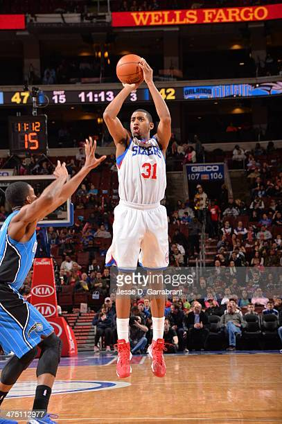 Hollis Thompson of the Philadelphia 76ers shoots the ball against of the Orlando Magic at the Wells Fargo Center on February 26 2014 in Philadelphia...