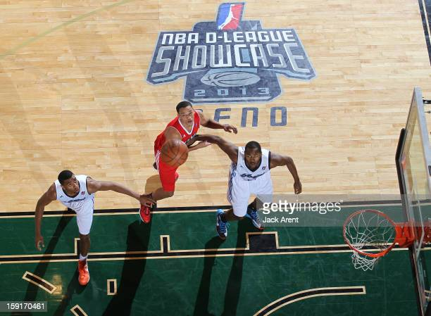 Hollis Thompson Rodney Bartholomew of the Tulsa 66ers and Omar Reed of the Main Red Claws look to rebound the ball during the 2013 NBA DLeague...