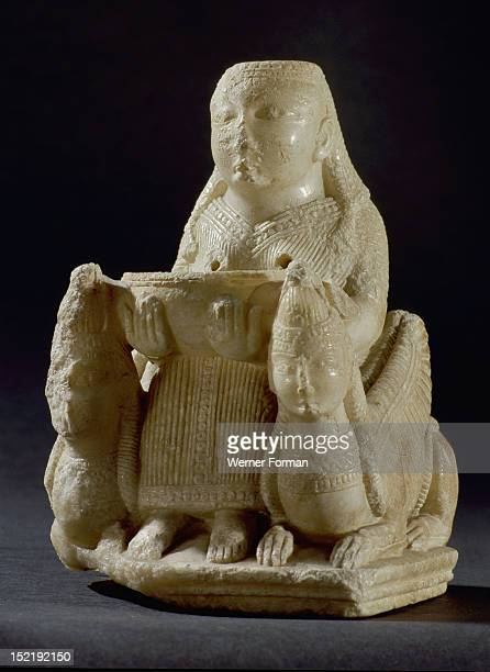 Hollowed out figure of a female goddess of oriental origin possibly associated with Astarte seated on a throne like chair flanked by two winged...
