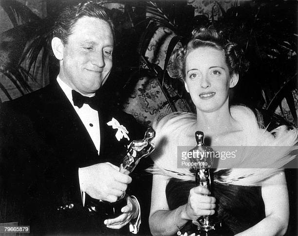 3rd March 1939 Hollwood California US Film stars Bette Davis with her academy award for Jezebel with Spencer Tracy with his award for the film Boys...