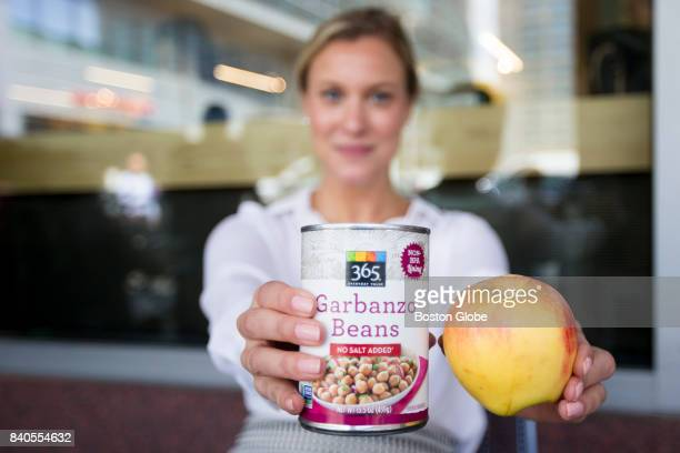 Holly Batchelder a health agency PR employee shows off her chick peas and apples which were discounted at a Whole Foods on Cambridge Street in Boston...